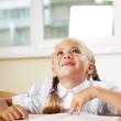 Portrait of a young girl in school at the desk. — Stock Photo #6330884
