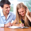 Stock Photo: Portrait of teacher helping young student with her studies in co