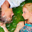 Portrait of sweet couple in love with soap bubbles around. P — Stock Photo #6419121