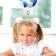 Little girl looking for a drawing concept wile painting picture — Stock Photo #6419241