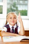 Bild des smart Kind interessante Lektüre im Klassenzimmer. Vert — Stockfoto