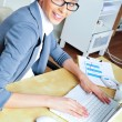 Beautiful business woman smiling while working with reports and — Stock Photo