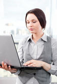 Beautiful business woman concentrating while working on computer — Stock Photo