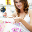 Happy shopping woman with bags and smiling. She is shopping insi — Stock Photo