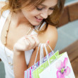 Happy shopping woman with bags and smiling. She is shopping insi — Stock Photo #6487069