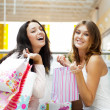 Two excited shopping woman together inside shopping mall. Horizo — Stock Photo #6487096