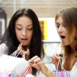 Two excited shopping woman together inside shopping mall. Horizo — Stock Photo #6487098