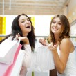 Two excited shopping woman together inside shopping mall. Horizo — Stock Photo #6567745