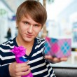 Portrait of young man inside shopping mall standing relaxed and — Stock Photo