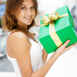 Stock Photo: Portrait of young excited pretty woman standing inside shopping