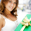 Portrait of young excited pretty woman standing inside shopping — Stock Photo #6567823