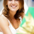 Portrait of young excited pretty woman standing inside shopping — Stock Photo #6567829