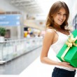 Portrait of young excited pretty woman standing inside shopping — Stock Photo #6567839