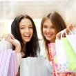 Two excited shopping woman together inside shopping mall. Horizo — Stock Photo #6569029