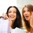 Stock Photo: Two excited shopping woman together inside shopping mall. Horizo