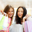 Two excited shopping woman together inside shopping mall. Horizo — Stock Photo #6569047