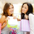 Two excited shopping woman together inside shopping mall. Horizo — Stock Photo #6569056