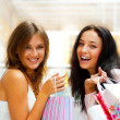 Two excited shopping woman together inside shopping mall. Horizo — Stock Photo #6569069
