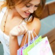 Стоковое фото: Happy shopping woman with bags and smiling. She is shopping insi