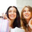 Two excited shopping woman together inside shopping mall. Horizo — Stock Photo #6580452