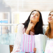 Two excited shopping woman resting on bench at shopping mall. Lo — Stock Photo #6580469