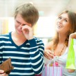 Woman cant stop shopping at mall - Foto Stock