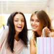 Two excited shopping woman together inside shopping mall. Horizo — Stock Photo #6580612