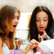 Stockfoto: Two excited shopping woman together inside shopping mall. Horizo