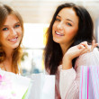 Two excited shopping woman together inside shopping mall. Horizo — Stock Photo #6580707