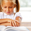 Image of smart child reading interesting book in classroom — Stock Photo #6582153
