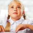 Portrait of a young girl in school at the desk. — Foto Stock