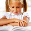 Image of smart child reading interesting book in classroom — Stock Photo #6582239