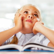 Portrait of a young girl in school at the desk. — Stock Photo #6582264