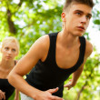 Closeup Portrait of Young Couple Jogging In Park — Stock Photo #6582279
