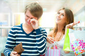 Woman cant stop shopping at mall — Stock Photo