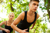 Closeup Portrait of Young Couple Jogging In Park — Stock Photo
