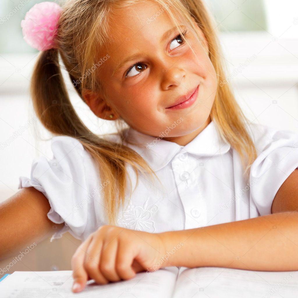 Image of smart child reading interesting book in classroom stock photo hasloo 6582218 - Bereik kind boek ...