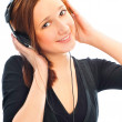Beautiful woman with headphones, she is listen to the music — Stock Photo