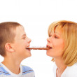 Portrait of happy european family of son and his mother eating c — Stock Photo