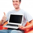Young man holding his laptop — Stock Photo #6654582