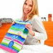 Beautiful young blond woman on the bed at home — Stock Photo