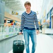 Portrait of a successful young man walking with travel bag at mo — Stock Photo #6654720