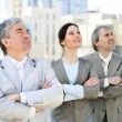 Portrait of three business outside. - Stockfoto