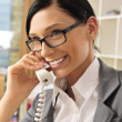 Portrait of a beautiful young businesswoman on the phone and hap — Stock Photo #6654810