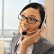 Portrait of a beautiful young businesswoman on the phone and hap — Stock Photo #6654825