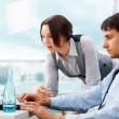 A business team of two colleagues planning work in office — Stock Photo