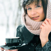 Portrait of young beautiful woman standing alone in winter park — Stock Photo