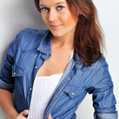 Portrait of a beautiful young woman wearing a denim shirt, tuggi — Stock Photo