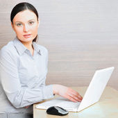 Portrait of a beautiful young businesswoman on the computer view — Stock Photo