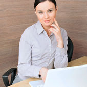 Portrait of a beautiful young businesswoman on the computer, lis — Stock Photo
